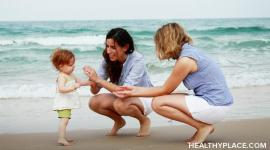 As a lesbian parent, should you come out to your children? Learn risks and benefits of lesbian parents coming out to children.